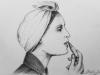 Naine huulepulgaga 2011 pliiats